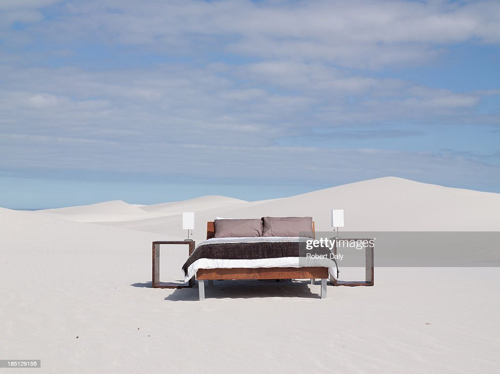 An empty bed in the middle of the desert : Stock Photo