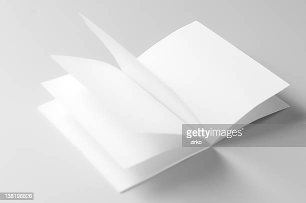 An empty blank brochure with its pages in motion