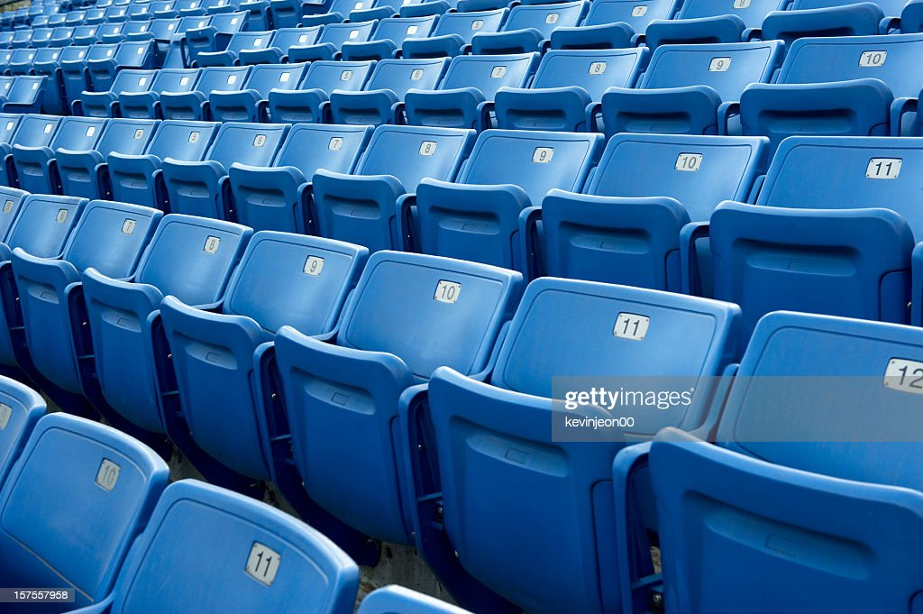 An empty blue arena seats with numbers : Stock Photo