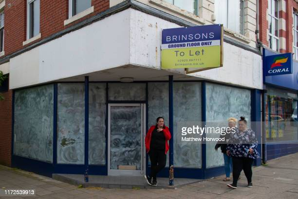 An empty boardedup shop on the high street on June 26 2019 in Caerphilly United Kingdom United Kingdom Large numbers of high street stores across the...