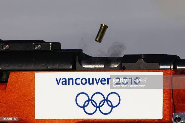 An empty bullet shell flies from an air rifle during the Biathlon Women's 15 km individual Zeroing on day 7 of the 2010 Vancouver Winter Olympics at...