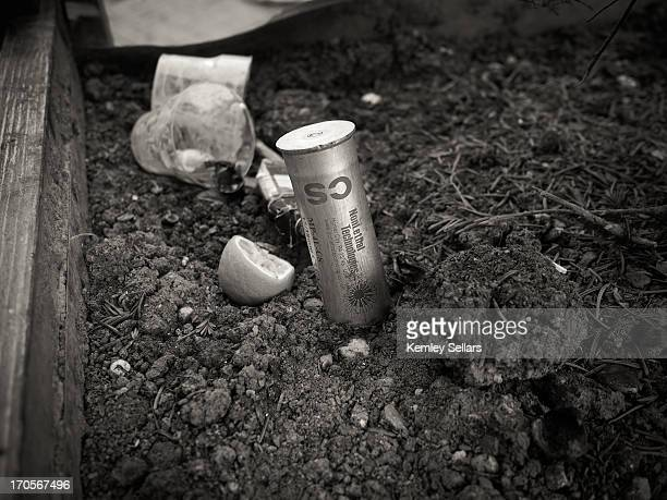 An empty CS canister has been placed in to a plant pot by a child who was playing with it. Fired by police after protests begun over redevelopment of...