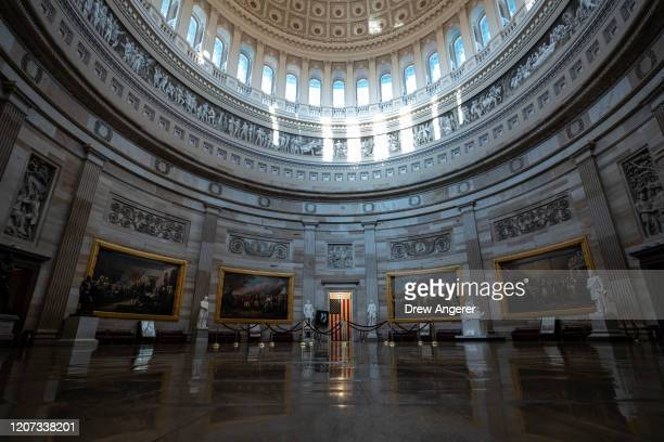 An empty Capitol Rotunda is seen on Monday morning at the US Capitol March 16 2020 in Washington DC After taking the weekend off the Senate will...