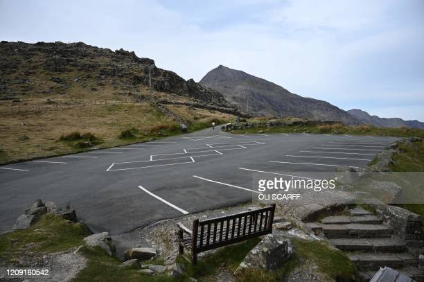 An empty car park is pictured at Pen-y-Pass, parking for Mount Snowdon, in north Wales on April 5, 2020 as the warm weather tests the nationwide...