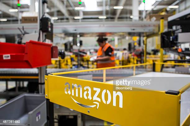 An empty cart stands in the distribution zone on the opening day of the new AmazonCom Inc fulfillment center in Dobroviz Czech Republic on Tuesday...