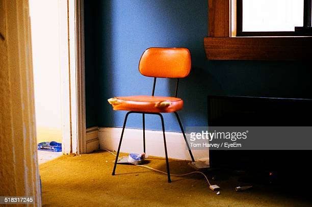An Empty Chair In A Room Corner