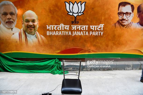 An empty chair is kept against the banner of Bharatiya Janata Party at the party headquarters in New Delhi on December 11 2018 India's ruling party...
