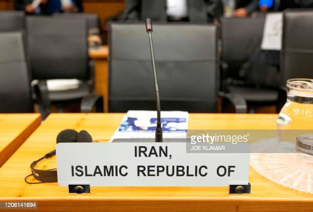 An empty chair of Iran's ambassador to International Atomic Energy Agency is seen at the opening of the IAEA Board Meeting at the agency's...