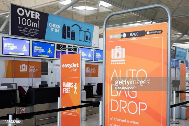 An empty check-in desk for EasyJet at Stansted Airport on June 30, 2020 in Stansted, United Kingdom. EasyJet have announced 5,000 job losses as it...