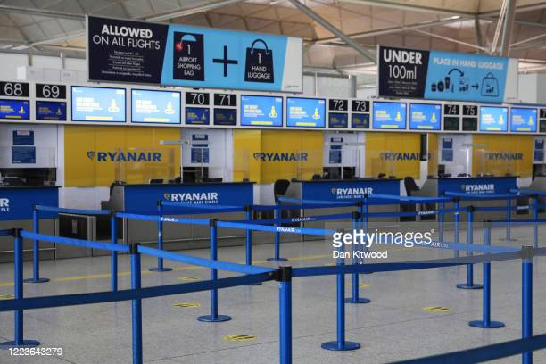 An empty check-in desk for Ryanair at Stansted Airport on June 30, 2020 in Stansted, United Kingdom. Passengers travelling between the UK and some...