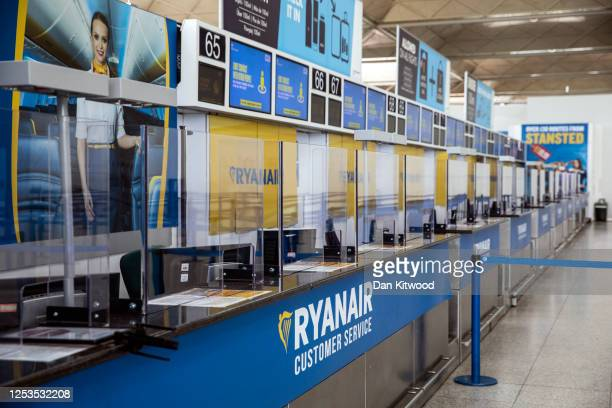 An empty checkin desk for Ryanair at Stansted Airport on June 30 2020 in Stansted United Kingdom Passengers travelling between the UK and some...