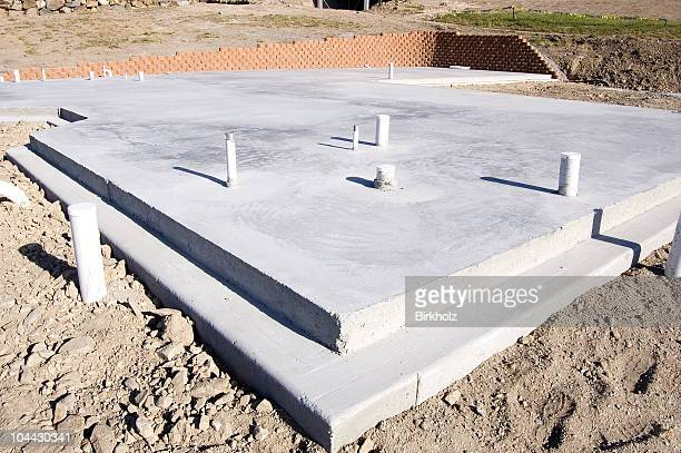 An empty concrete slabs on a dirt lot