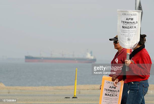 An empty container ship is anchored at the entrance to the harbor as members of the International Longshore and Warehouse Union strike putting a halt...