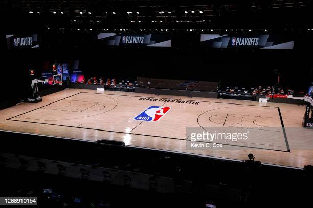 An empty court and bench is shown with no signage following the scheduled start time in Game Five of the Eastern Conference First Round between the...