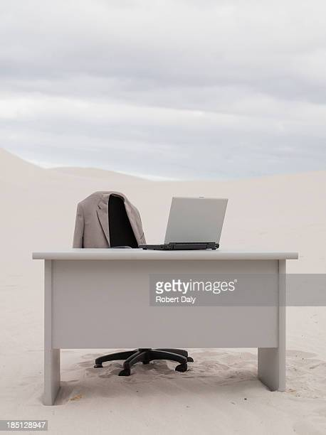 an empty desk in the middle of a desert - remote location stock pictures, royalty-free photos & images