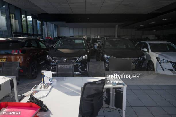 An empty desk sits in a Peugeot Citroen automobile dealership in London, U.K. On Monday, April 20, 2020. European car sales dropped the most on...