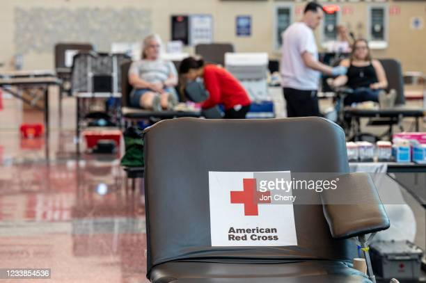 An empty donation table with the American Red Cross logo is seen at the KFC YUM! Center during the Starts, Stripes, and Pints blood drive event on...