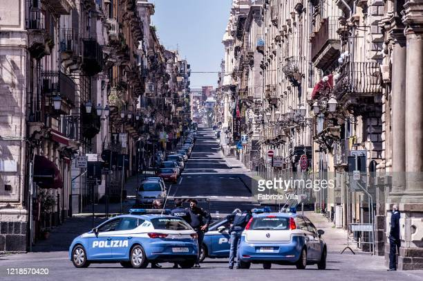 An empty downtown street with police patrols on Easter Monday on April 13 2020 in Catania Italy Easter celebrations go on throughout Italy which...
