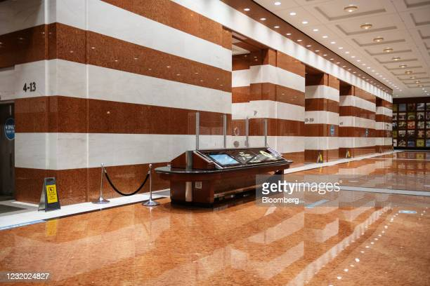 An empty elevator area and security desk in the lobby of the Bay Wellington Tower on Bay Street in Toronto, Ontario, Canada, on Thursday, March 25,...