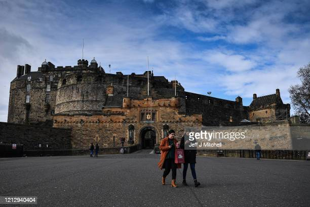 An empty esplanade at Edinburgh Castle on March 17, 2020 in Edinburgh, Scotland.Scottish people have been urged to avoid all non-essential travel and...