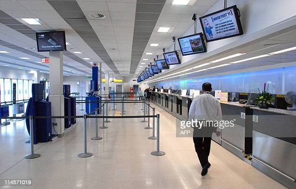 An empty flight CheckIn area is pictured at Aberdeen Airport in Scotland on May 24 2011 A plume of ash from an erupting Icelandic volcano headed for...