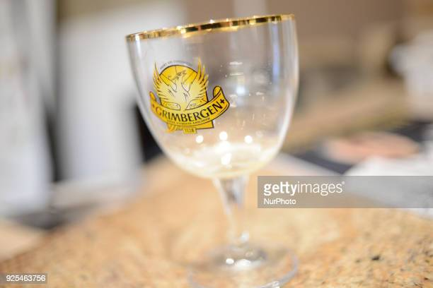 An empty glass of Grimbergen Belgian abbey beer is seen in Warsaw Poland on February 27 2018