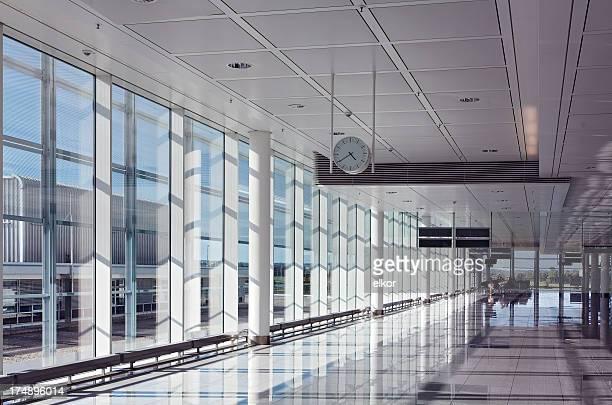 An empty hallway at an airport terminal