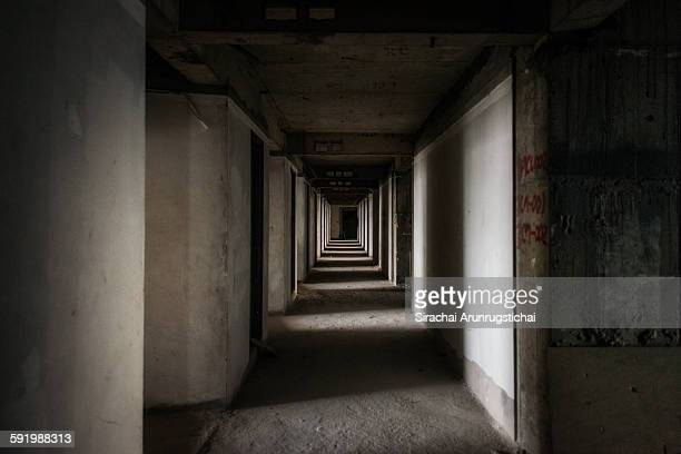 An empty hallway in an abandoned skyscraper
