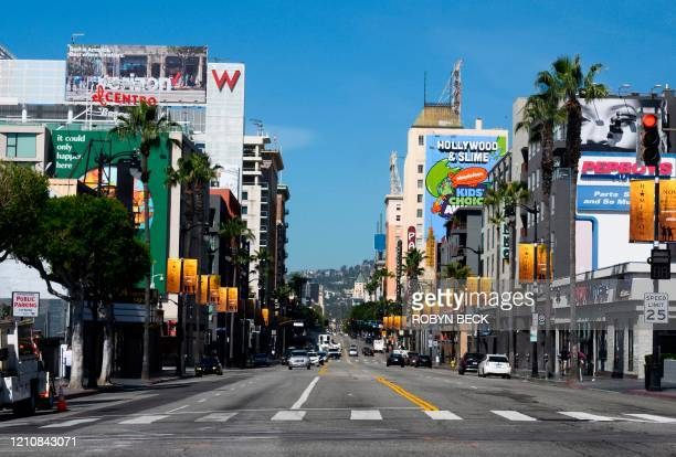 An empty Hollywood Blvd is viewed in Hollywood, California during the coronavirus COVID-19 pandemic, April 23, 2020. - Movie theaters and the...