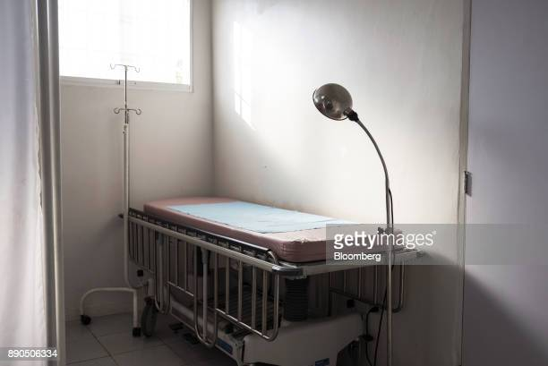 An empty hospital bed stands in a room at a women's public hospital in Barcelona Venezuela on Tuesday Aug 22 2017 The ruling party'slandslide...