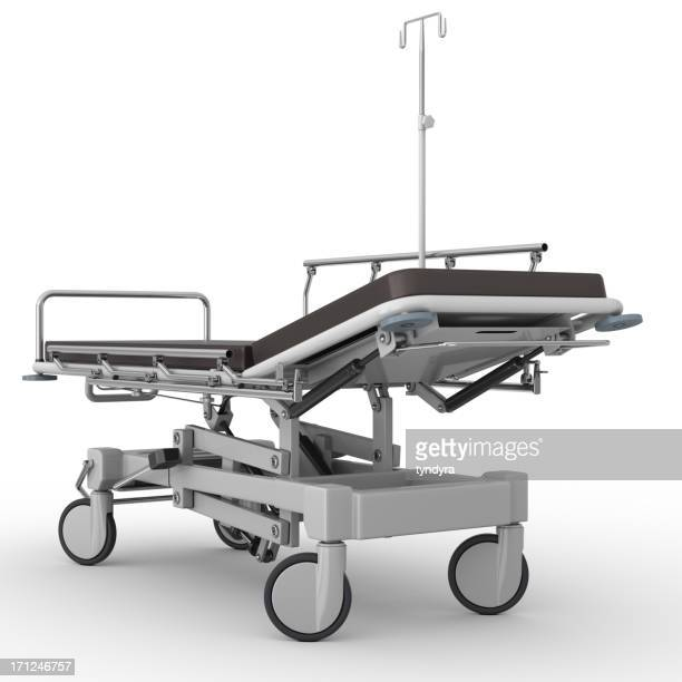 An empty hospital stretcher isolated on a white background
