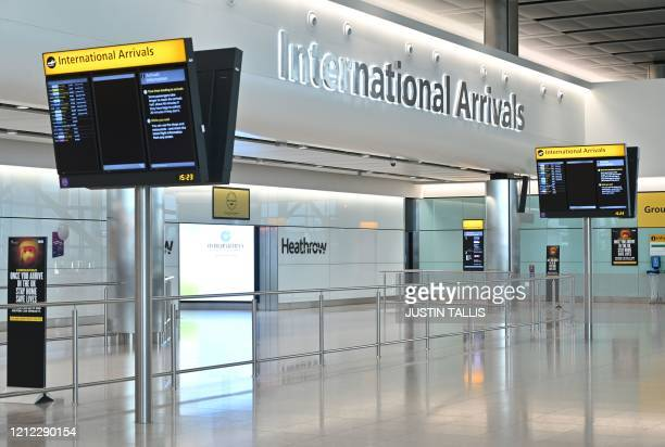 An empty International Arrivals hall is pictured at Terminal Two of London Heathrow Airport in west London, on May 9, 2020. - Britain could introduce...