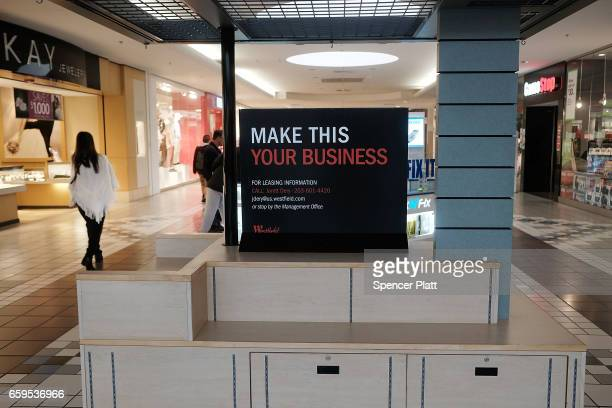 An empty kiosk stands in the Westfield Meriden shopping mall on March 28 2017 in Meriden Connecticut As consumers buying habits change and more...