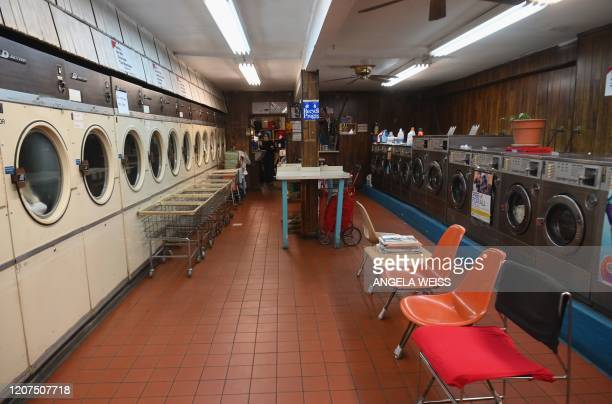 An empty laundromat on March 17 2020 in the Brooklyn Borough of New York City The coronavirus outbreak has transformed the US virtually overnight...