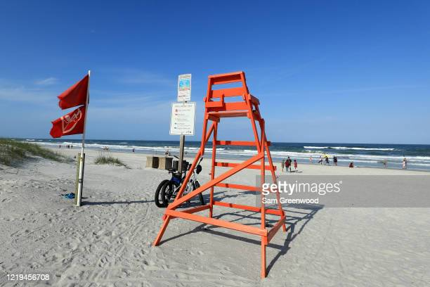 An empty life guard chair is seen at the beach on April 17 2020 in Jacksonville Beach Florida Jacksonville Mayor Lenny Curry announced Thursday that...