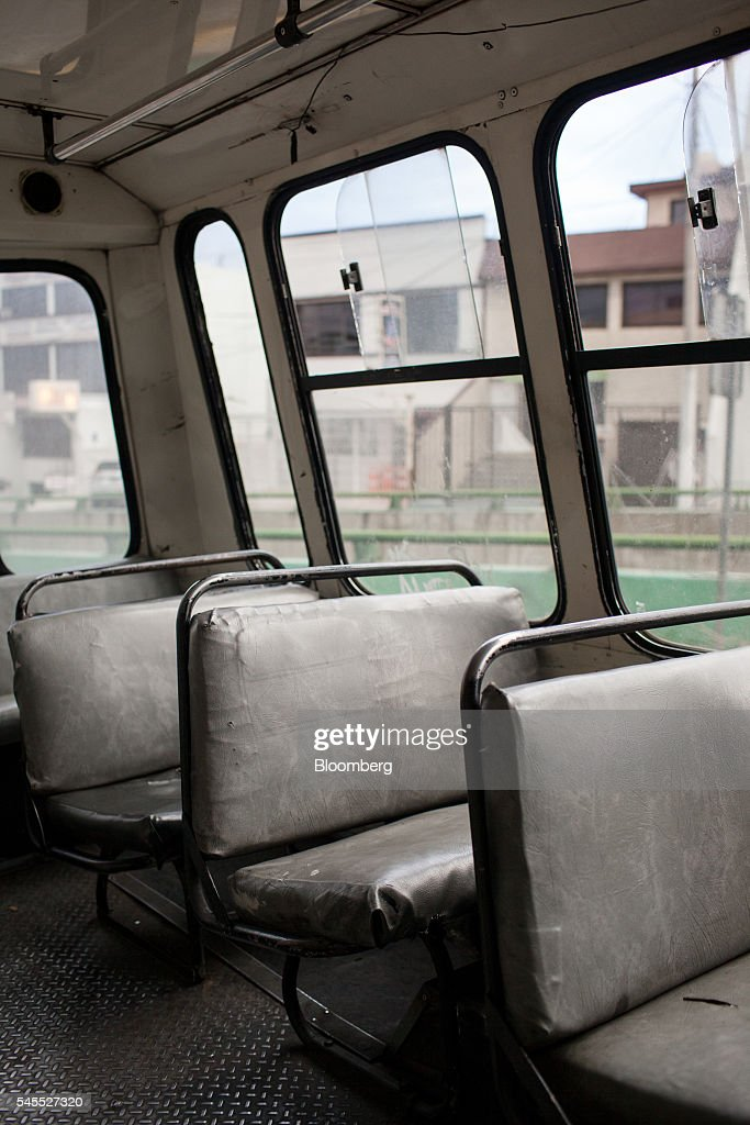 An empty micro bus sits in Mexico City, Mexico, on Tuesday, June 28, 2016. The air quality in Mexico City has risen above the government's acceptable limits triggering restrictions on automobile usage and stricter vehicle emissions testing. Photographer: Brett Gundlock/Bloomberg via Getty Images