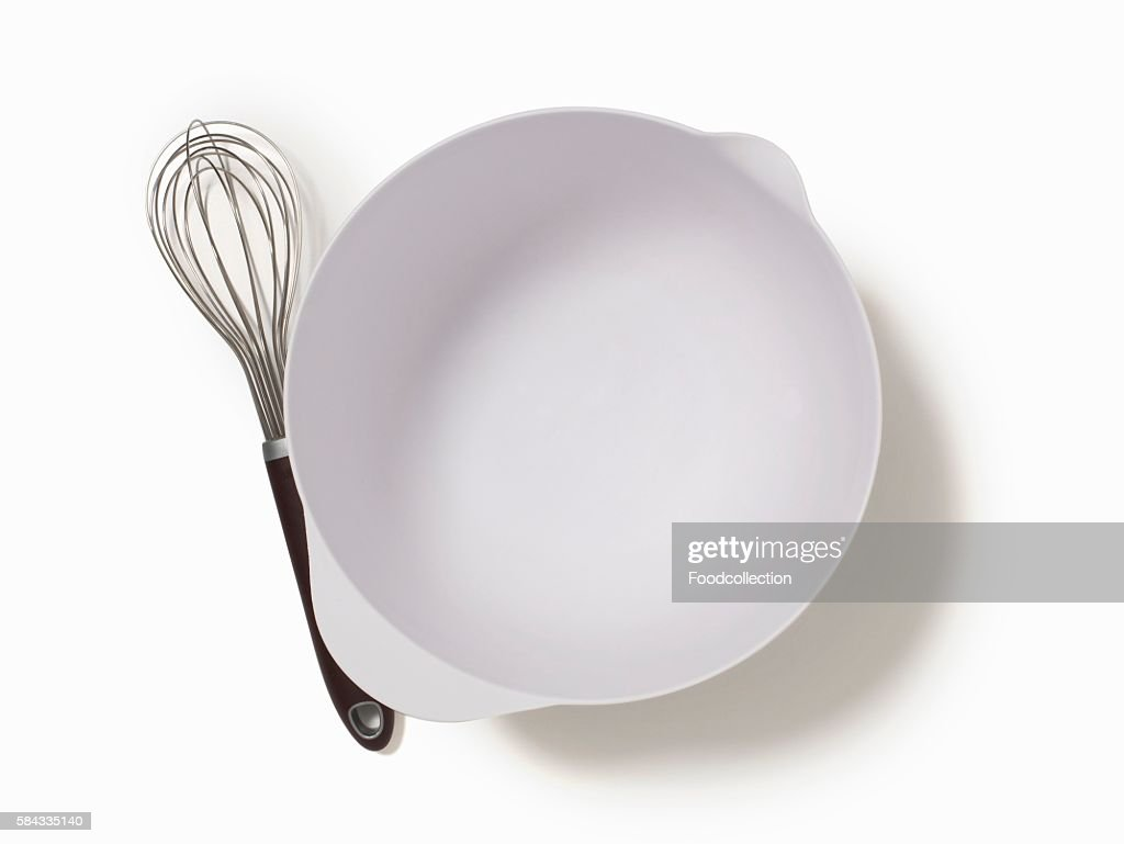 An Empty Mixing Bowl and a Whisk; From Above; White Background : Stock Photo