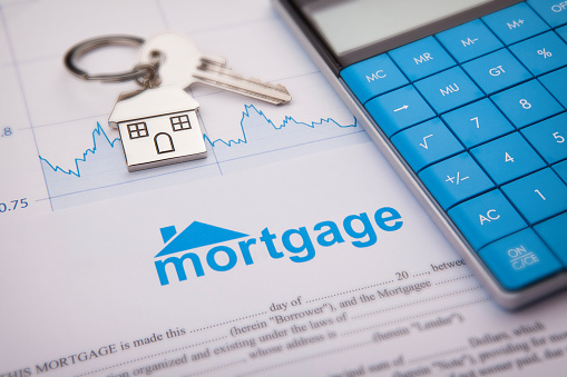 An empty mortgage application form with house key 1133438028