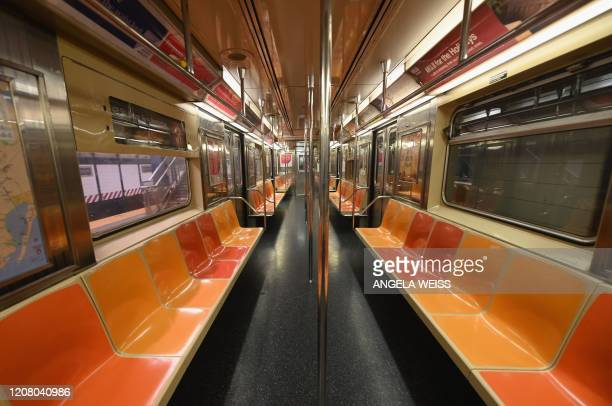 TOPSHOT An empty New York Subway car is seen on March 23 2020 in New York City Wall Street fell early March 23 2020 as Congress wrangled over a...