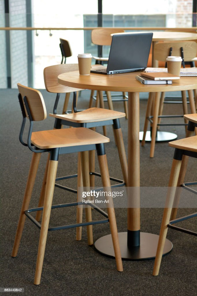 An empty office space with furniture and items : Stock Photo