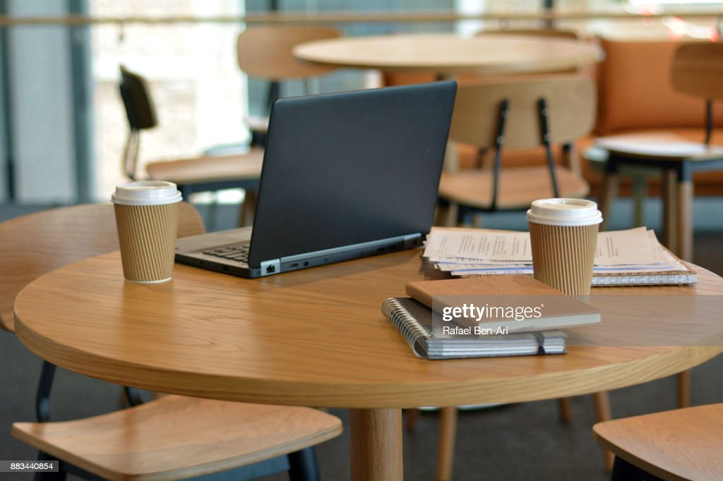 An empty office space with furnitures and items : Stock Photo
