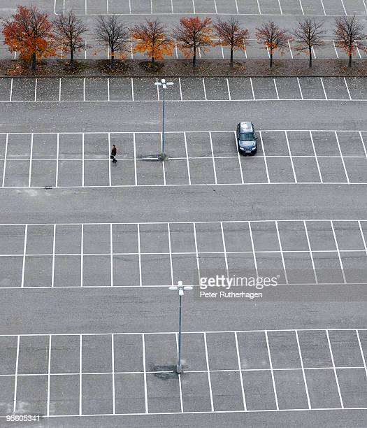 An empty parking lot except for one car Sweden.