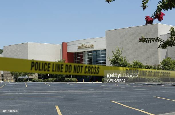 """An empty parking lot if seen outside The Grand Theatre in Lafayette, Louisiana on July 24 following a deadly shooting the night before. A """"drifter""""..."""