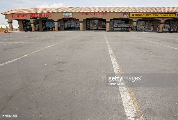 An empty parking lot is seen in front of a row of mostly Hispanic businesses closed as part of a 'Day Without Immigrants' May 1 2006 in Las Vegas...