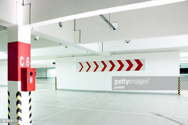 An empty parking lot with directional arrows