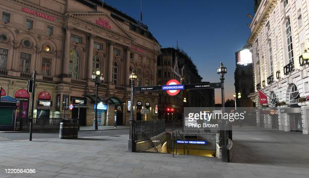 An empty Piccadilly Circus as the sun rises on April 23, 2020 in London, England. The British government has extended the lockdown restrictions first...