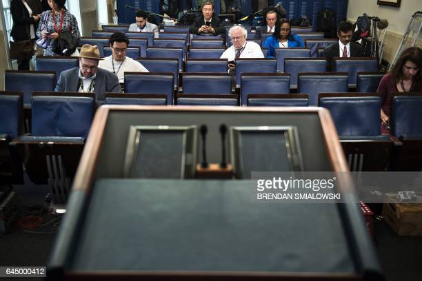 An empty podium is seen as an off camera briefing is held with a small group of reporters and White House Press Secretary Sean Spicer instead of the...