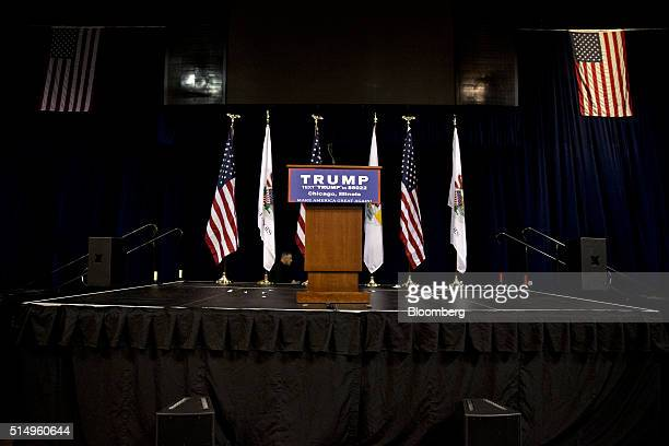 An empty podium stands on stage during a canceled campaign event with Donald Trump, president and chief executive of Trump Organization Inc. And 2016...