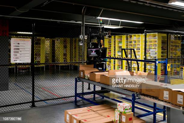 An empty 'Random Stow' workplace where employees pack goods into robotic shelves utilized for quick access is seen during a tour of Amazon's...