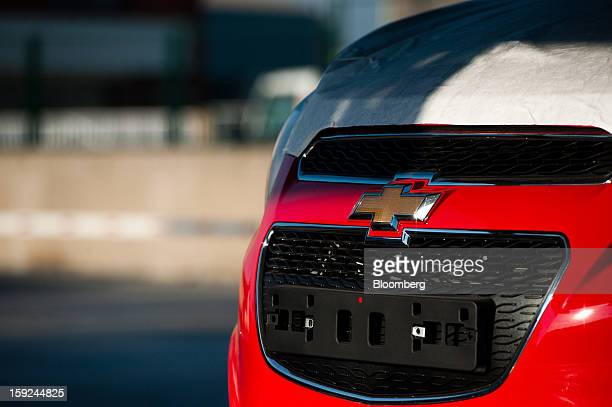 An empty registration plate fixing is seen on the rear of a General Motors Co Chevrolet automobile before shipping at Barcelona port in Barcelona...